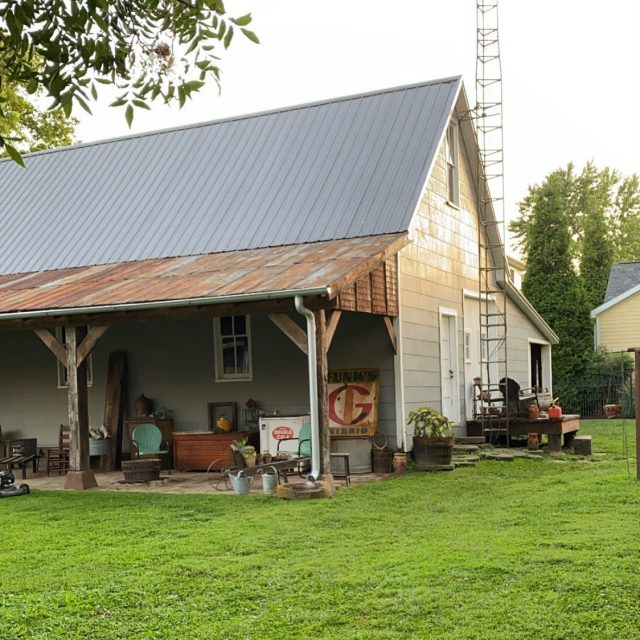 "Let me tell you what I know about our barn... ..  It was a John Deere Dealership in in 1938 & 1939 😍 and the Cottage (our Airbnb) we believe was the sales office. .. The John Deere Dealership closed in the late 1930s.  In the late 1940s the front third of the barn was torn down & the wood was saved to create what is now our home. You can see the old barn wood in our basement and believe me, it is rock solid! I'll share it w you in my stories later.  .. We added the porch a few months ago which we named the ""Lean to"" because that's what we've always called tractor sheds on sides of barns. It was my husband's design and we used salvaged materials found by our local picker friends who I've tagged!  .. If you come visit us at the shop, ask us to go to The Barn. Hoping one day to have Barn events where we can all shop, hug & be together. Until then, you are welcome to visit us here in New Harmony...our Airbnb cottage link is in our bio & our IG just for newharmonycottage is live!  .. .. #firehouseantiques #etsysellsvintage #visitindiana #myvintagetoucheshome #myvintageviews #etsyvintageseller  #visionsofvintage  #blameitonmyvintageheart #Followmetojunk #architecturalsalvage #myantiquedhome #pickerslife #farmsigns #indianabarns #visitnewharmony #vintageadvertising #salvagedmaterials #johndeere  #tractorshed #historymeetsdecor"
