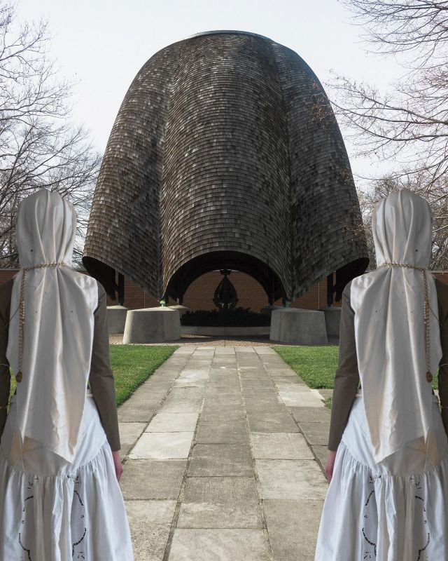 """Twin peaks on the sweet earth of a historic American utopia. The first interdenominational experiment of its kind was seeded in 1824 by #robertowen here in #newharmonyindiana. The #rooflesschurch where I stand mirroring is a personal memorial to a year of infinite reflection. This image is symbolic of more than I can put into words. Designed by #philipjohnson in 1960 the roofless church is not only what you see, an inverted rosebud enclosure functioning as the protective cover for a #jacqueslipchitz sculpture but the """"church"""" itself is the entire city block plaza because only one roof — the sky — can encompass the eternal spirit of humanity. Happy New Year 🌹 we're in this together y'all 🌹 with love  xxxx"""